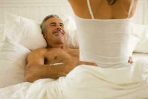 Woman on Top of Man in Bed --- Image by © Richard Schultz/Corbis